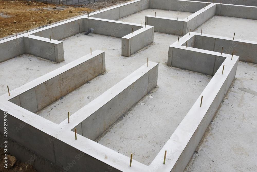 Fototapeta Foundation work of housing construction