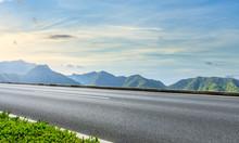 Asphalt Highway And Beautiful Natural Landscape At Sunset