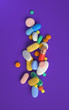 Leinwanddruck Bild - pile of colorful pills,3d rendering,conceptual image.