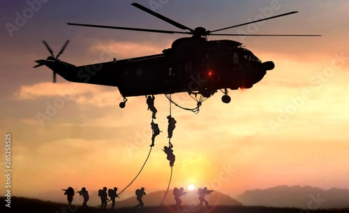 Deurstickers Helicopter Military commando helicopter drops in silhouette during sunset