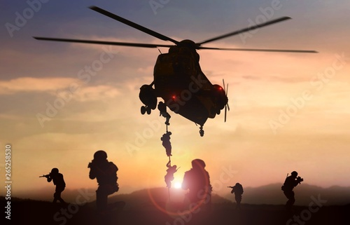 Fotografie, Tablou Special force assault team helicopter drops during sunset