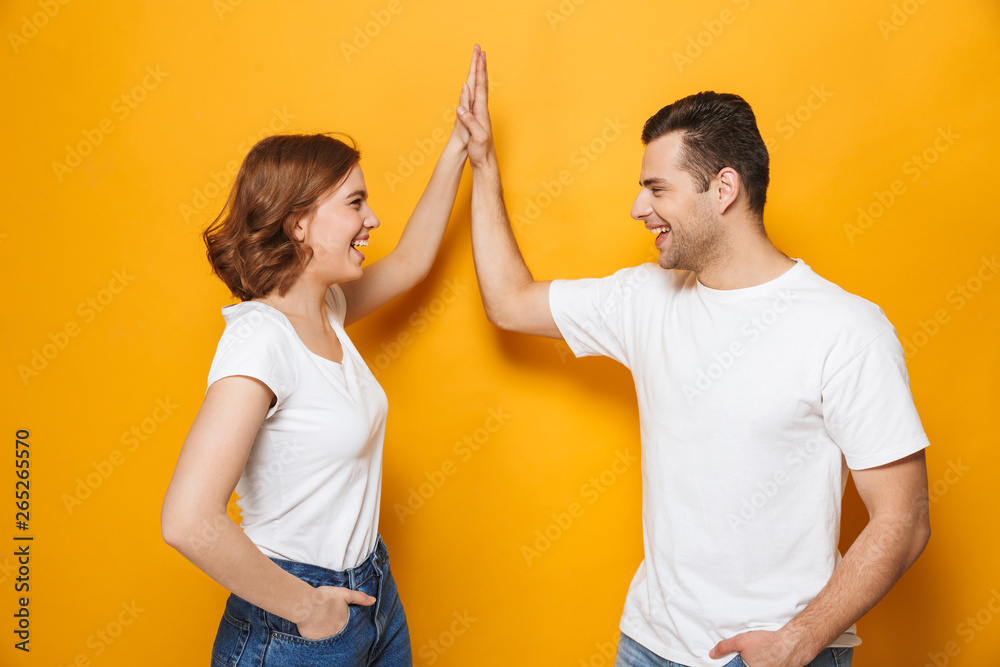 Fototapety, obrazy: Excited beautiful couple wearing white t-shirts standing