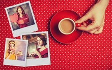 Female Hand Holding Cup Of Coffee And Memories Images On A Polka Dot Surface Table.
