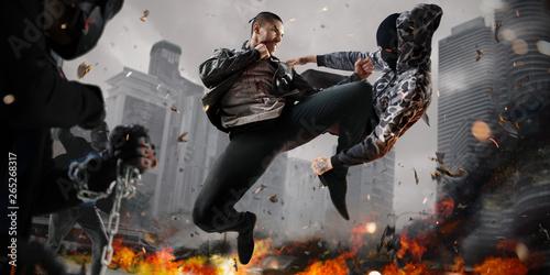fototapeta na lodówkę Street fighter super heroin action. around fire and smoky town