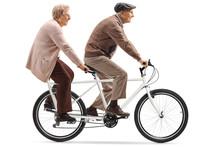 Senior Man And Woman Riding A Tandem Bicycle