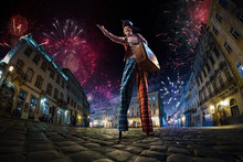 Night Street Circus Performance Whit Clown. Festival City Background. Fireworks And Celebration Atmosphere. Wide Engle Photo