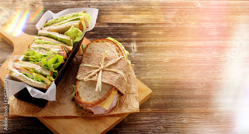 Staande foto Snack Fresh sandwich with ham cheese and lettuce in bakery mold