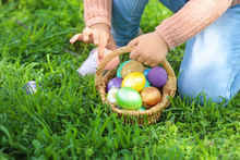 Little Girl Gathering Easter Eggs In Park, Closeup
