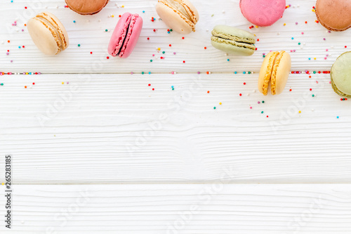 Staande foto Macarons Macarons design on white wooden background top view space for text