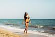 Beautiful young woman on the beach. Body, beautiful booty, summer.