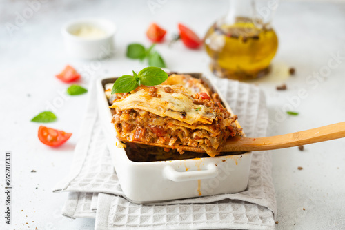 Fototapeta Tasty lasagne with meat, cheese on white plate obraz