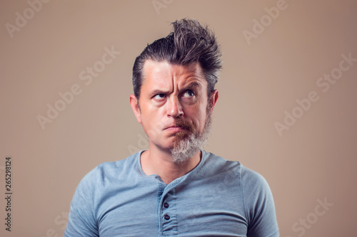 Fotomural  A portrait of man with half beard and hair