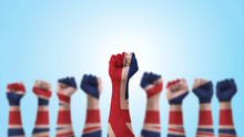 May Day UK Labour Day Concept With British United Kingdom Flag Pattern On People Clenched Fist Of Man's Hand Isolated On Blue  Background With Clipping Path