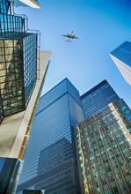 An Airplane Flies Overhead Tor...