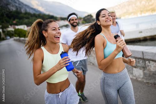 Poster de jardin Kiev Outdoor portrait of group of friends running and jogging in nature