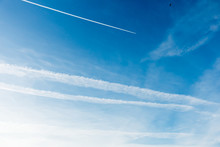 Sky Covered With Chemtrails And Plane Leaving A Contrail, Chemtrail
