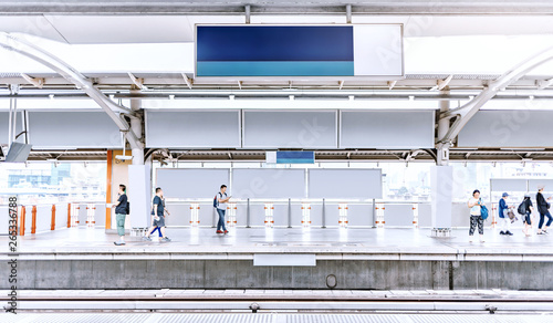 Leinwand Poster train station platform with blank billboard advertising