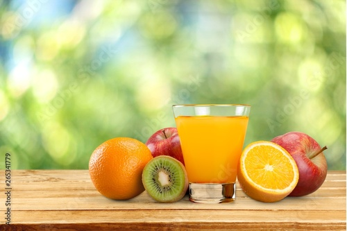 Poster de jardin Nature Tasty fruits and juice with vitamins on background