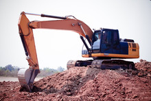 Excavator Or Backhoe At The Co...
