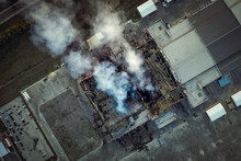 Top Down View Of Smoke Clouds From Burnt Warehouse Building With Burned Roof, Fire Disaster Accident In Cargo Logistics Storehouse, Aerial Shot