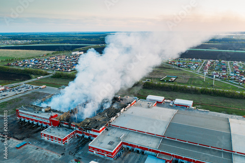 Smoke after fire in burnt distribution warehouse of network Magnit on area of Wallpaper Mural