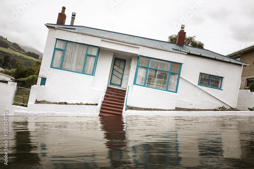 Flooding with a crooked house Canvas Print