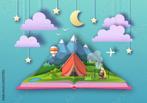 Fotografia Open fairy tale book with Mountains landscape and camping