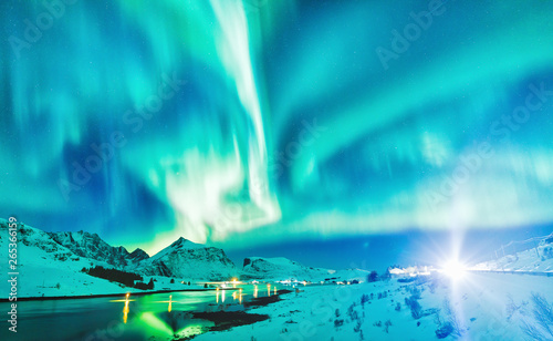 Poster Aurore polaire Aurora Borealis natural phenomenon on Lofoten Islands in Norway, Scandinavia, Europe. Night sky with northern lights over mountains and road reflected in fjord. Night winter landscape with aurora.