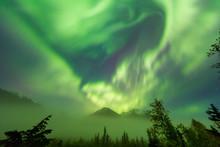 Bright Green Aurora Borealis Dances Over The Kenai Mountains, Moose Pass, Kenai Peninsula, South-Central Alaska; Alaska, United States Of America
