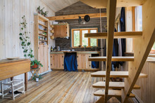 Retractable Pinewood Stairs And Kitchen Area With 100 Year Old Maple Wood Cabinets, Pantry Inside A Rustic Cottage Style 11.5 X 32 Foot Open Concept Design Mini-House; Quebec, Canada