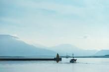 Fishing Boat Leaving Reykjavik Harbour On A Calm Morning; Reykjavik, Iceland