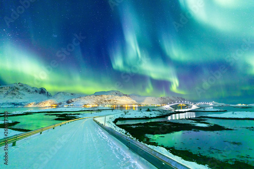 Foto auf Gartenposter Landschaft Aurora Borealis natural phenomenon on Lofoten Islands in Norway, Scandinavia, Europe. Night sky with northern lights over mountains and road reflected in fjord. Night winter landscape with aurora.