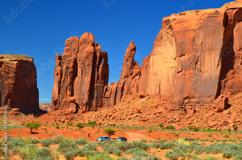 Poster Corail Monument Valley is a region of the Colorado Plateau characterized by a cluster of vast sandstone buttes above the valley floor. It is located on the Arizona-Utah state line, USA