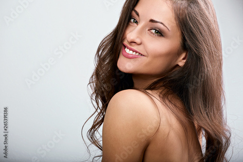Fotografie, Obraz  Beautiful natural makeup toothy smiling woman with long hair style