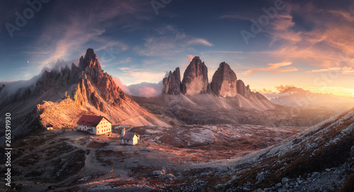 Mountain valley with beautiful house and church at sunset in spring. Landscape with buildings, high rocks, colorful sky, clouds, sunlight. Mountains in Tre Cime park in Dolomites, Italy. Italian alps - 265391930