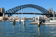 Sydney Harbour Bridge With Boats And Pier And City
