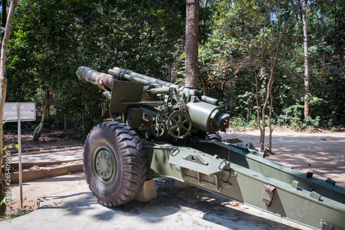 Front view of a 155mm Vietnam War artillery on display at Cu Chi Tunnels in Saigon, Vietnam Wallpaper Mural