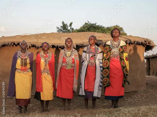 fototapeta na lodówkę wide shot of a group of maasai women singing