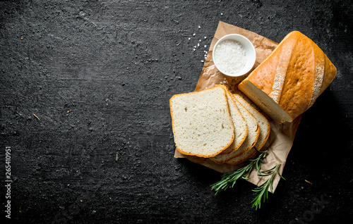 Staande foto Brood Pieces of fragrant bread with salt and rosemary.