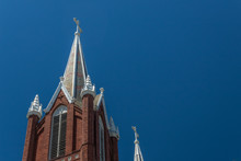 Gothic Revival Church Steeples With Crosses, Very Sunny Day, Blue Sky, Horizontal Aspect