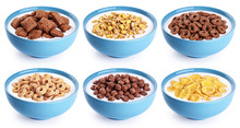 Bowl With Corn Pads, Rings, Balls, Oat Granola, Cornflakes And Yogurt Isolated On White Background.
