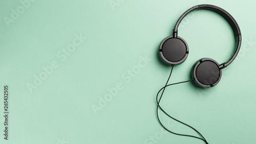 Black headphones on Mint background Fototapeta