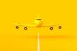 Yellow plane flying on the runway.