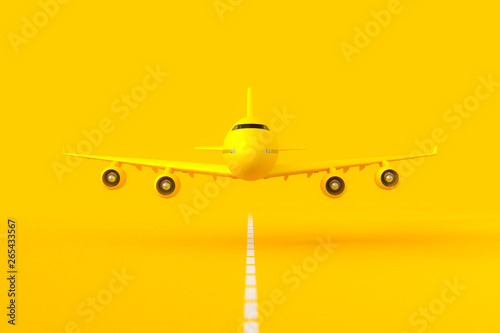 Yellow plane flying on the runway.