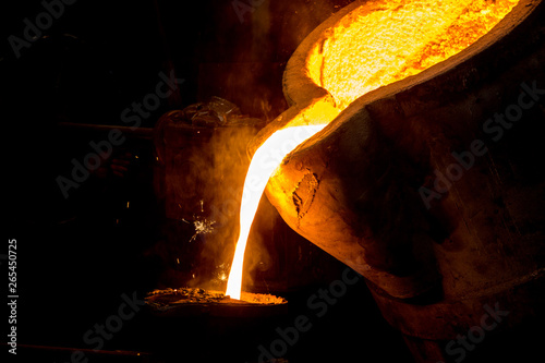 Fotomural  metal casting process with red high temperature fire in metal part factory