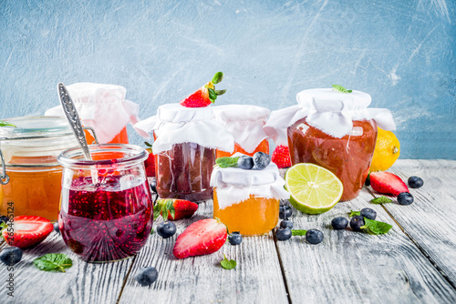Fototapety, obrazy: Assortment of berry and fruit jams