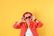 canvas print picture - Portrait of cool grandmother on color background