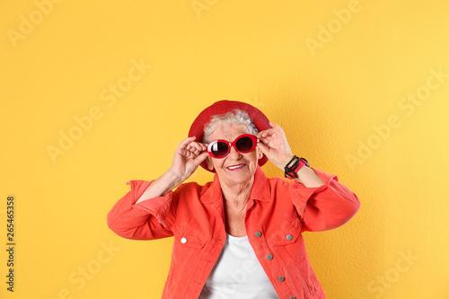 Obraz na plátne Portrait of cool grandmother on color background