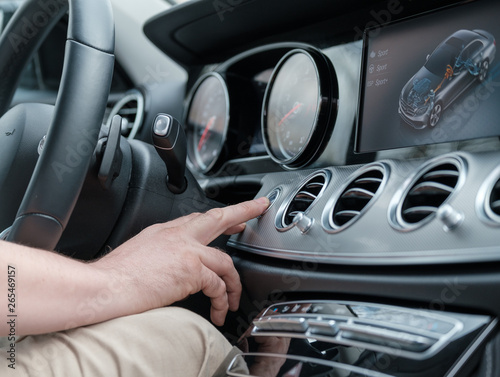 Photo Man testing additional car control at luxury car