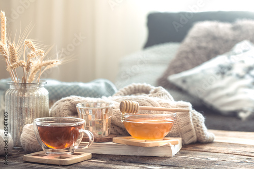 Poster Thee Still life details of home interior on a wooden table with a Cup of tea